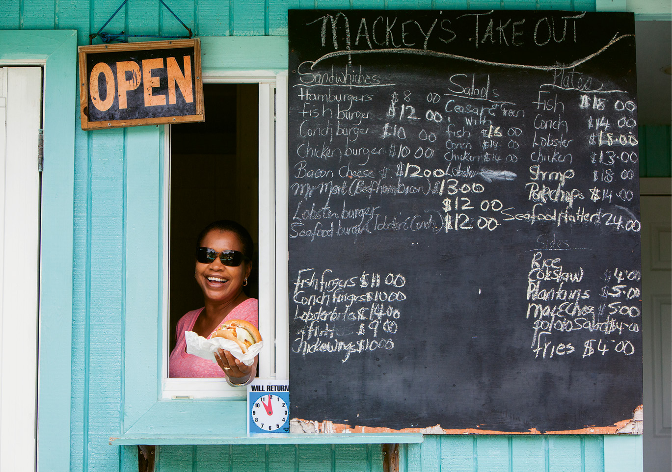 Friendly window service at Mackey's Takeout, a favorite lunch stop for fresh seafood.