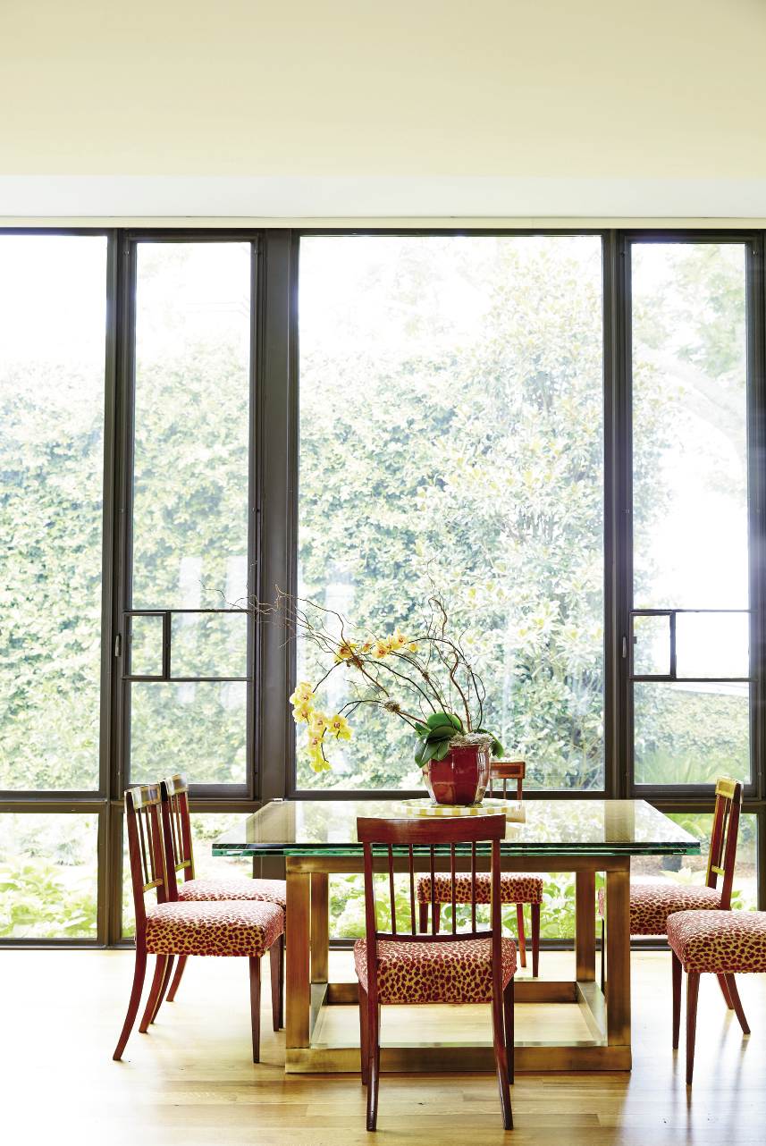 A wall of new floor-to-ceiling windows opens up the kitchen/breakfast/family room to bright morning light and garden views, as well as a peek-a-boo of the harbor to the east.