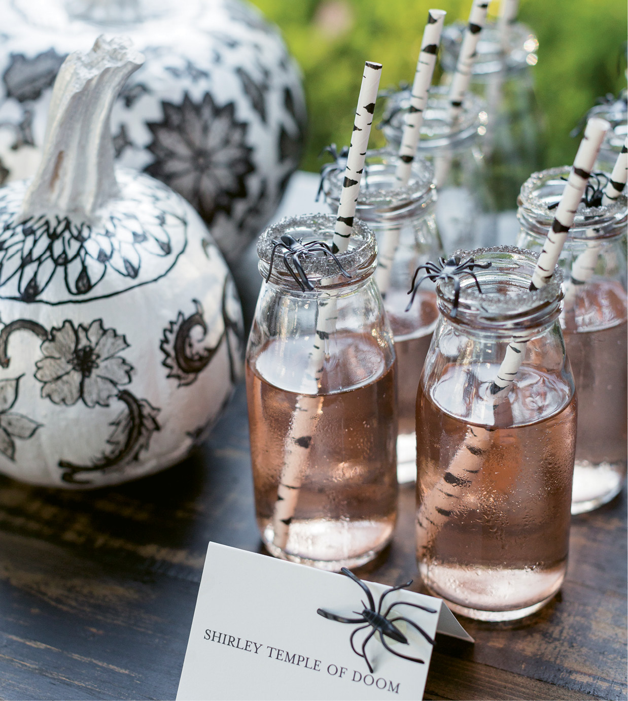 "Patterned straws and spooky garnishes elevate the simplest cocktail, notes Batch bar service's Katie Poole. ""A specialty drink is usually guests' first impression,"" she continues, ""so in a way, it's the microcosm of the entire event."" The jelly-bean bar stays fresh (read: not sticky) thanks to lidded apothecary jars."