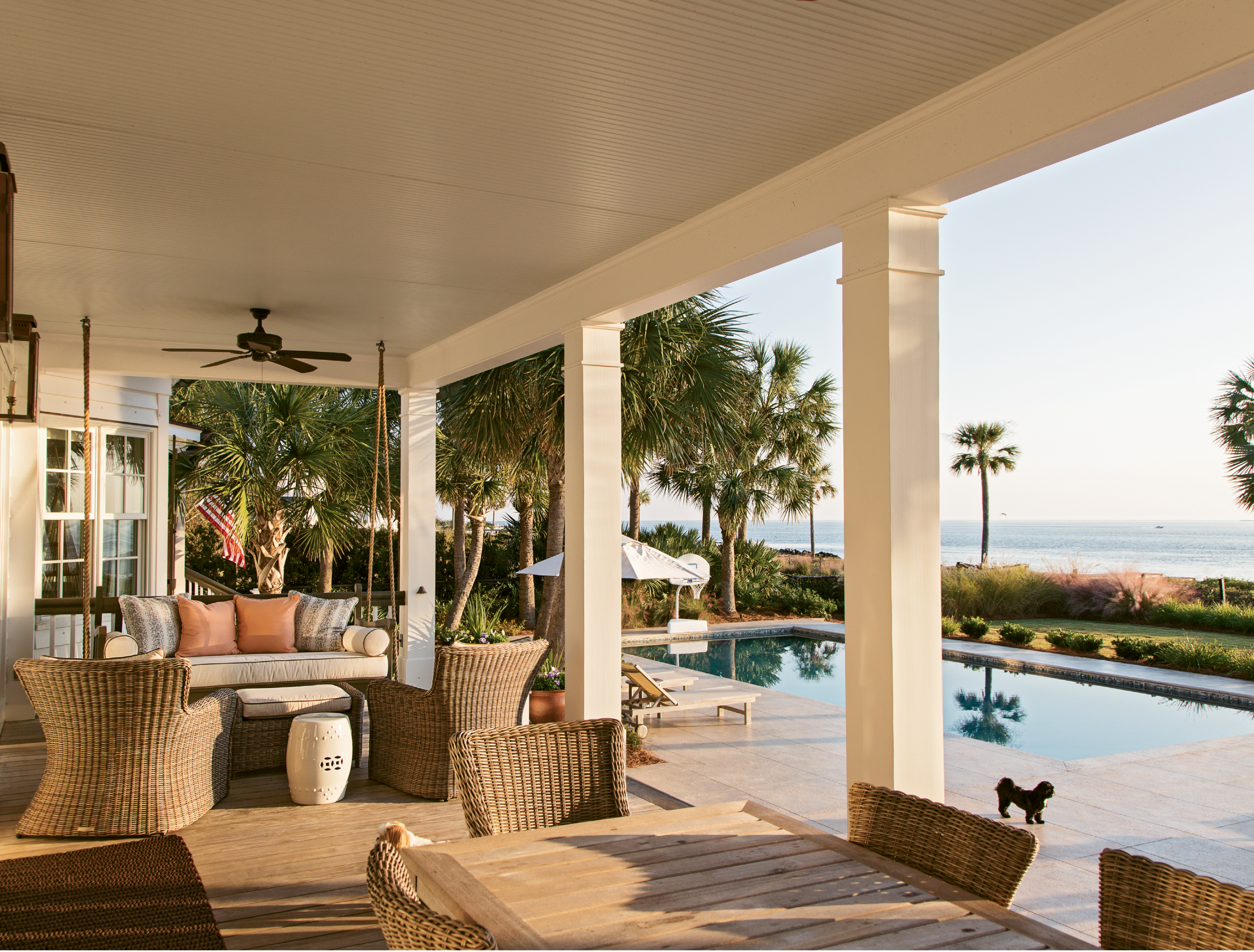 """JUMP IN: """"We all pretty much live on the back porch,"""" says Tara. Palmetto trees and the harbor provide a scenic backdrop for regular swims and backyard parties, especially the family's annual Fourth of July shindig."""