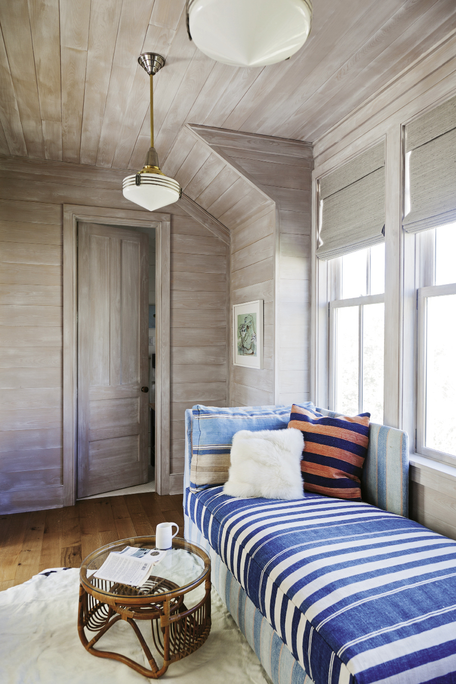 "Cozy bedrooms and bunks abound to fit in plenty of visitors, including a double-duty sleeper bench upholstered in a vintage dhurrie in the cedar-lined ""office"""