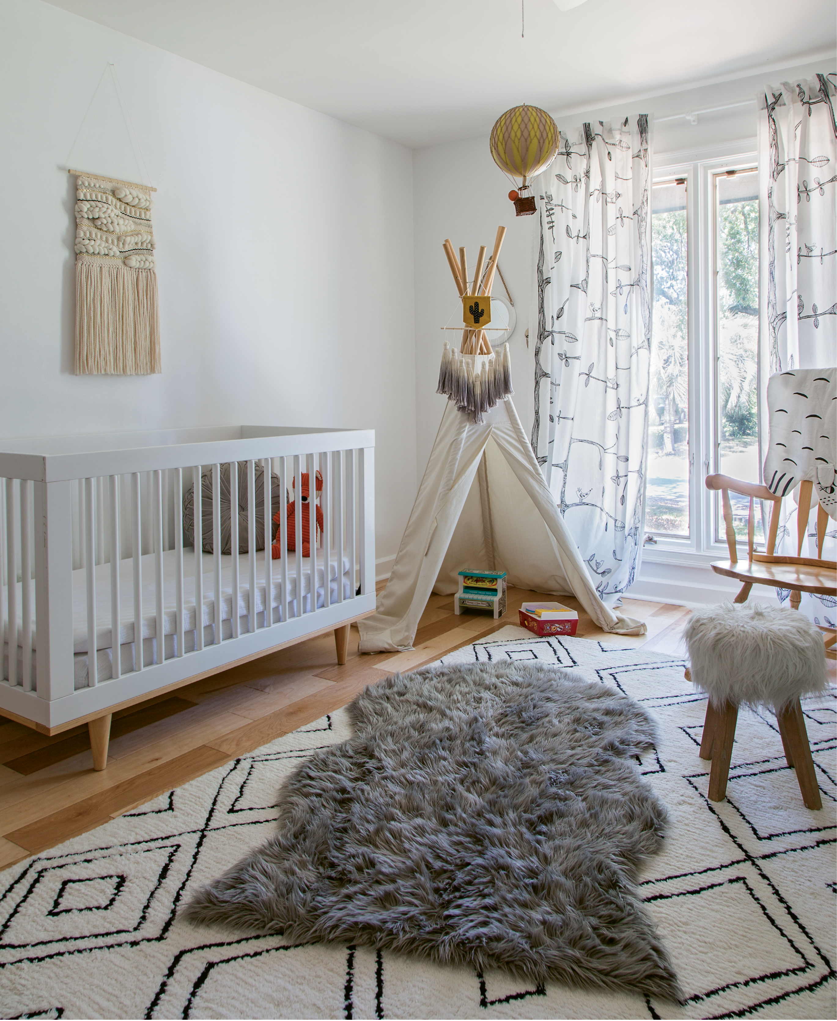 COOL KIDS: The nursery is playful and fun, but still feels sophisticated thanks to a black-and-white palette.