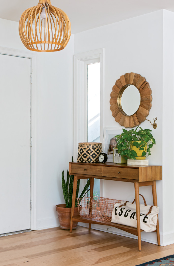 A mid-century-inspired console from West Elm anchors the foyer.