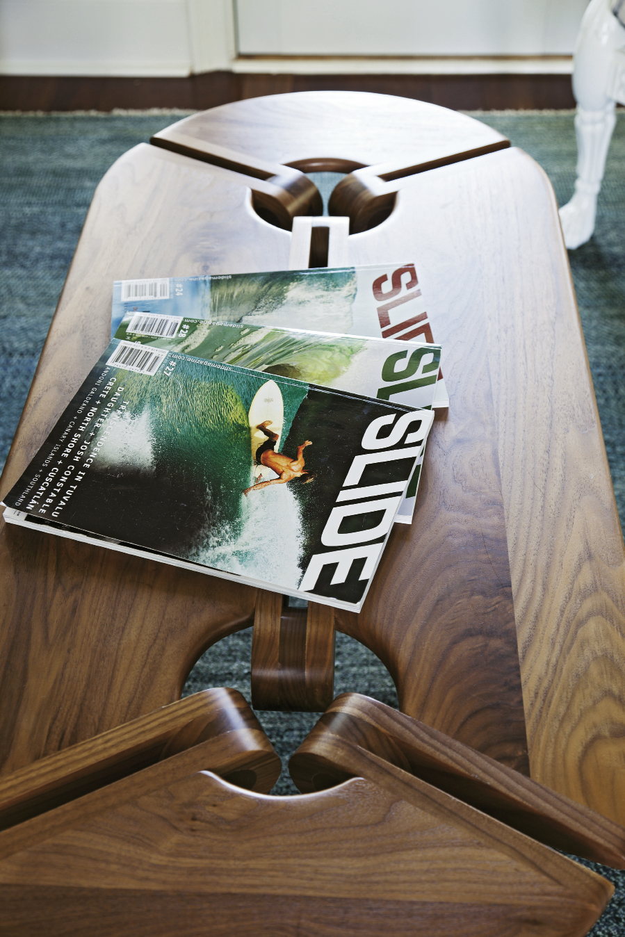 Surf magazines put a personal stamp on a mid-century-style coffee table by New Breed Furniture Network.