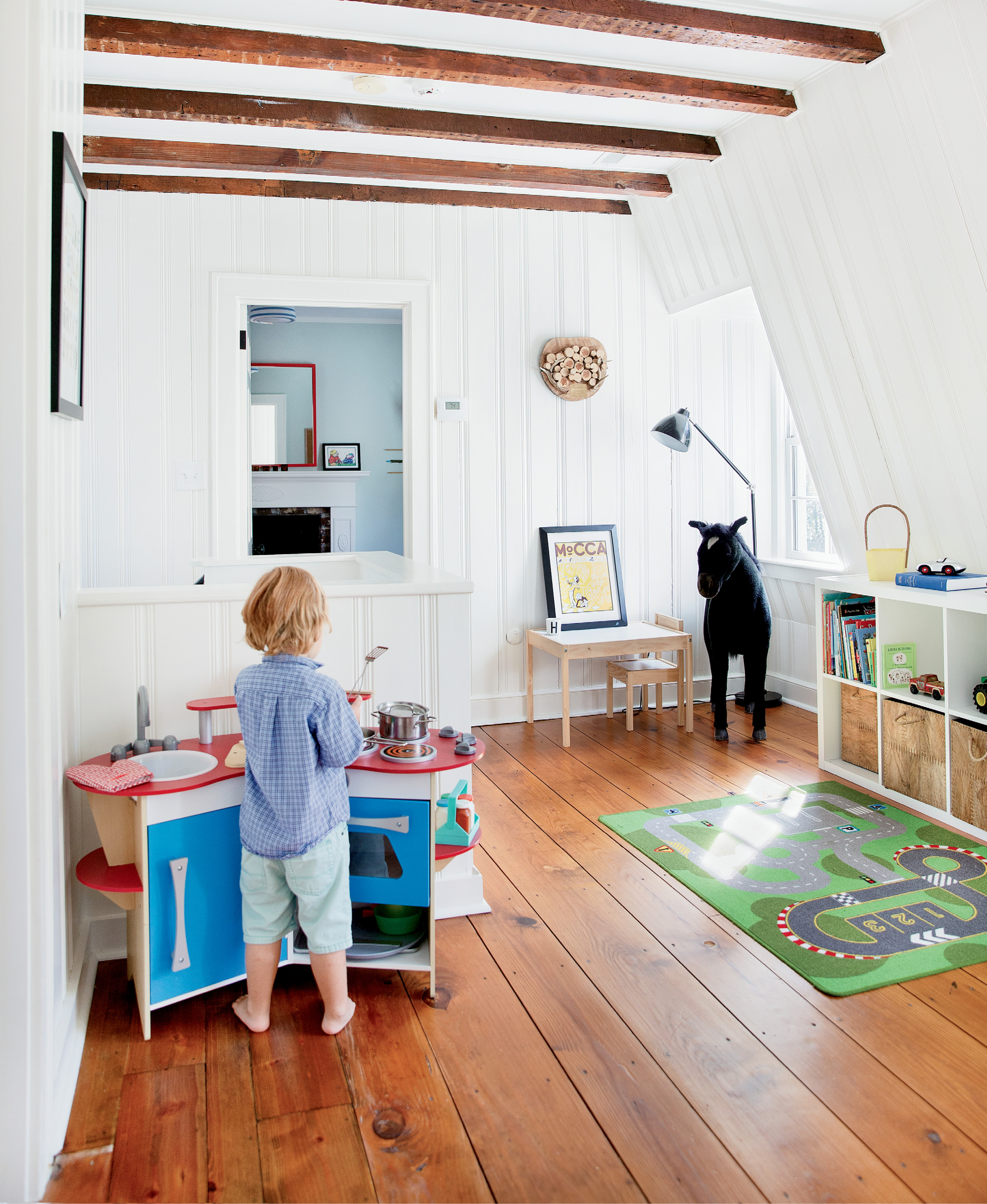 Henry whips up some pretend grub in his playroom, which retains its 18th-century footprint, as does his adjoining bedroom.
