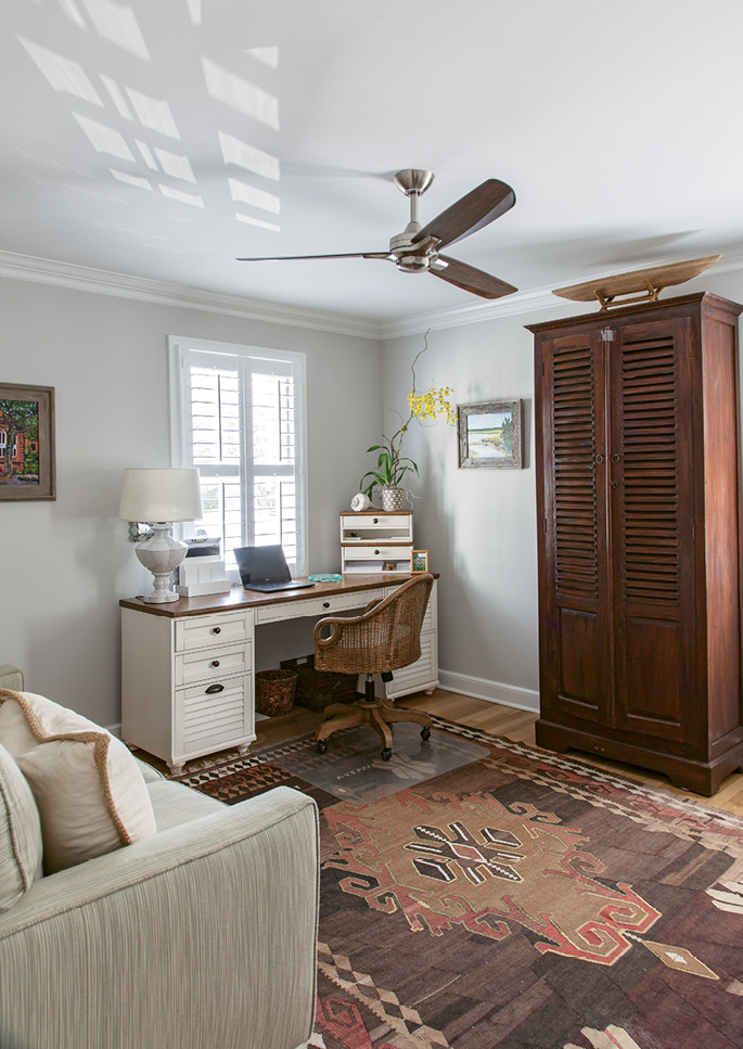 Rachel often sets up shop in her office (the desk is from Pottery Barn; and the armoire, Nadeau; the rug is a family heirloom).