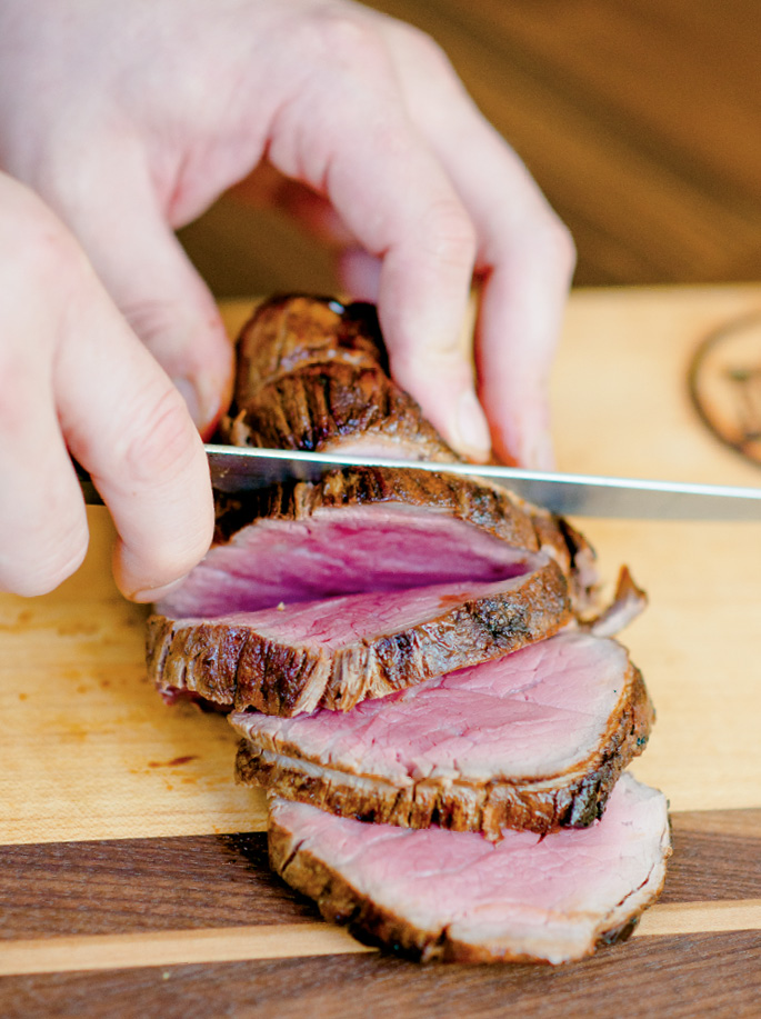 Prime Cut: Using indentations from the butcher's twine as a guide makes slicing the châteaubriand a snap.