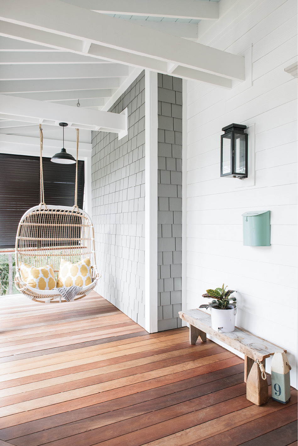 """I love that the design is modern yet has a vintage appeal about it,"" says Melissa about the rattan porch"