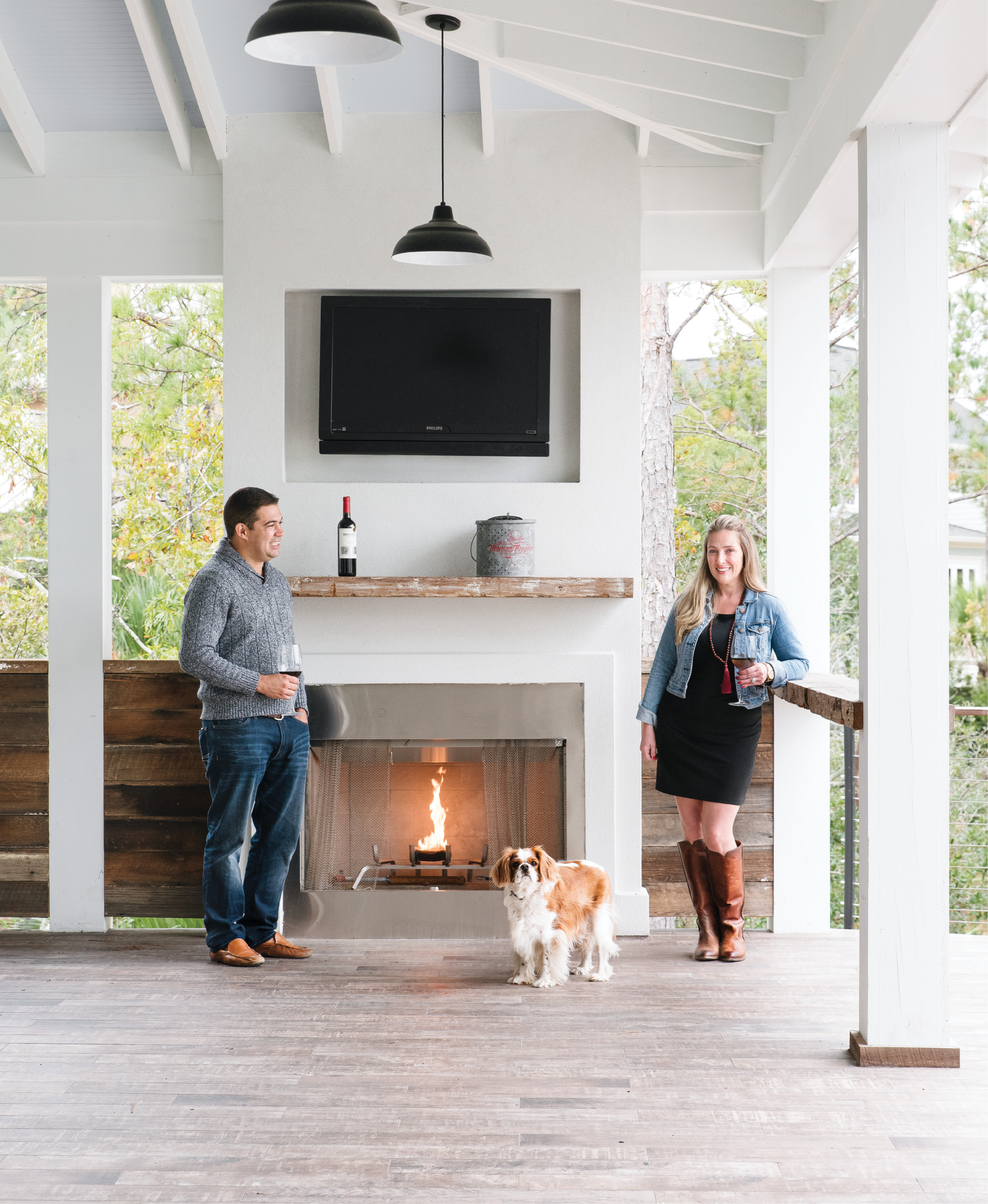 Cooler temps don't keep Melissa and Valmar Nunes and their adorable pup, Mason, cooped up indoors. The couple designed their RiverTowne abode—complete with a marsh-front pool, open-air kitchen, and this alfresco fireplace—for outdoor entertaining year-round.