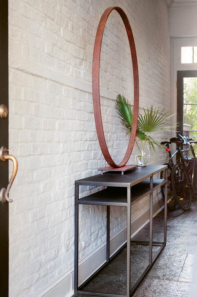 Inside, visitors are met with an antique carriage wheel; the sculptural metal object by stylist and artist Nathalie Naylor could easily be mistaken for a work of modern art.