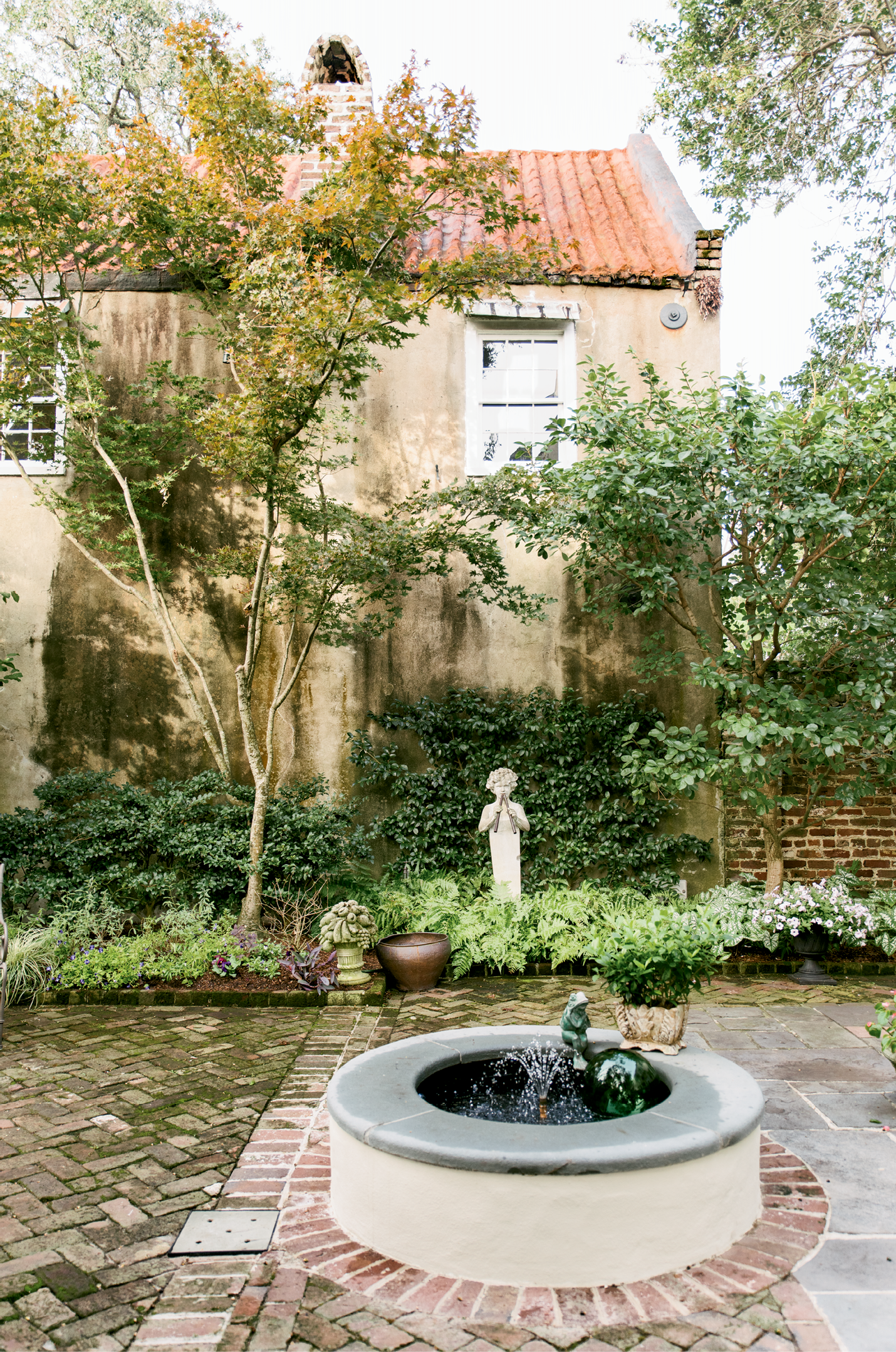 A previous owner filled in this fountain, which anchors the rear courtyard. Monica had it restored and rebuilt, returning the space's signature water feature.