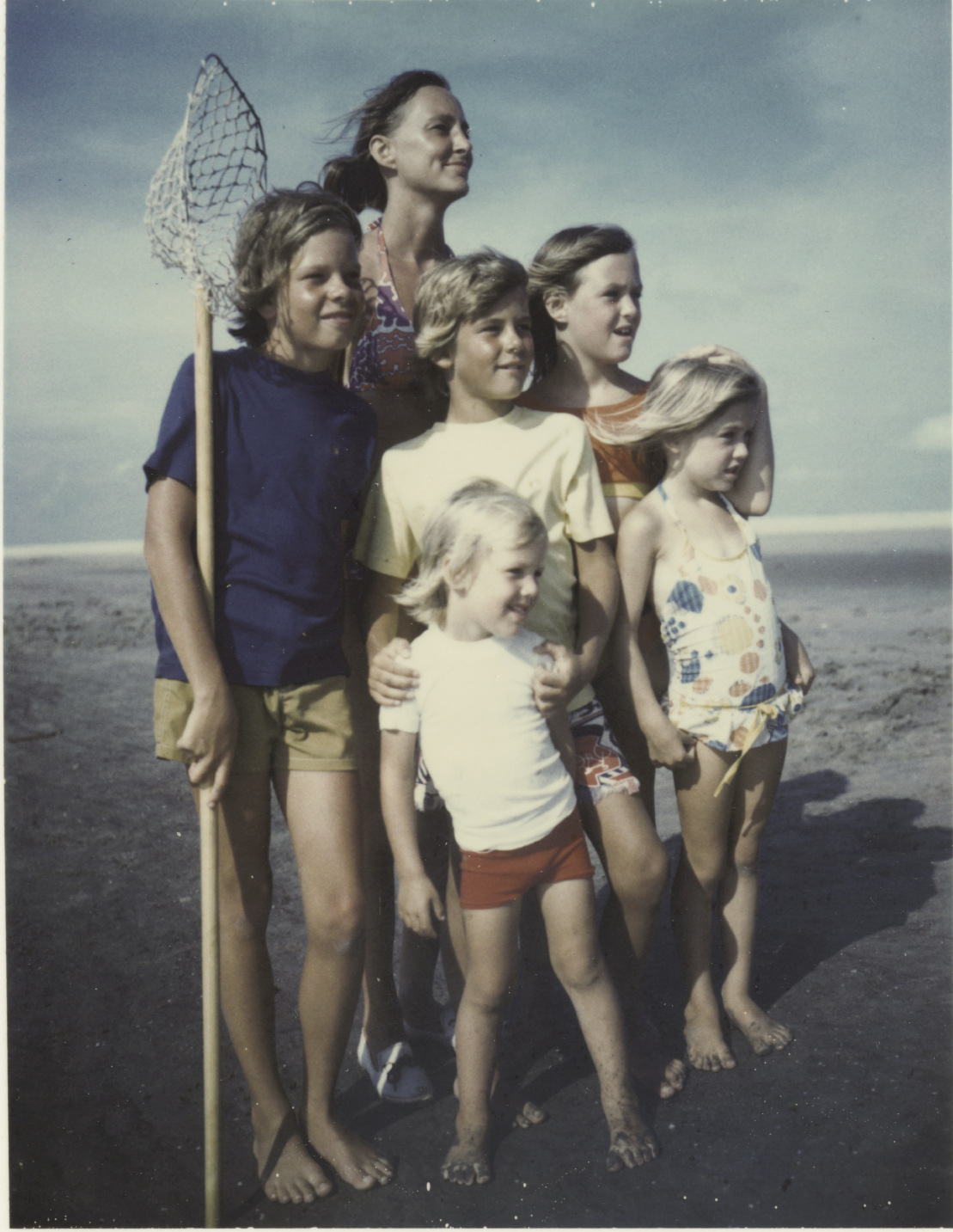 Author Edward Marshall's stepmother, Lynn, stands ready to catch crabs with her extended brood.