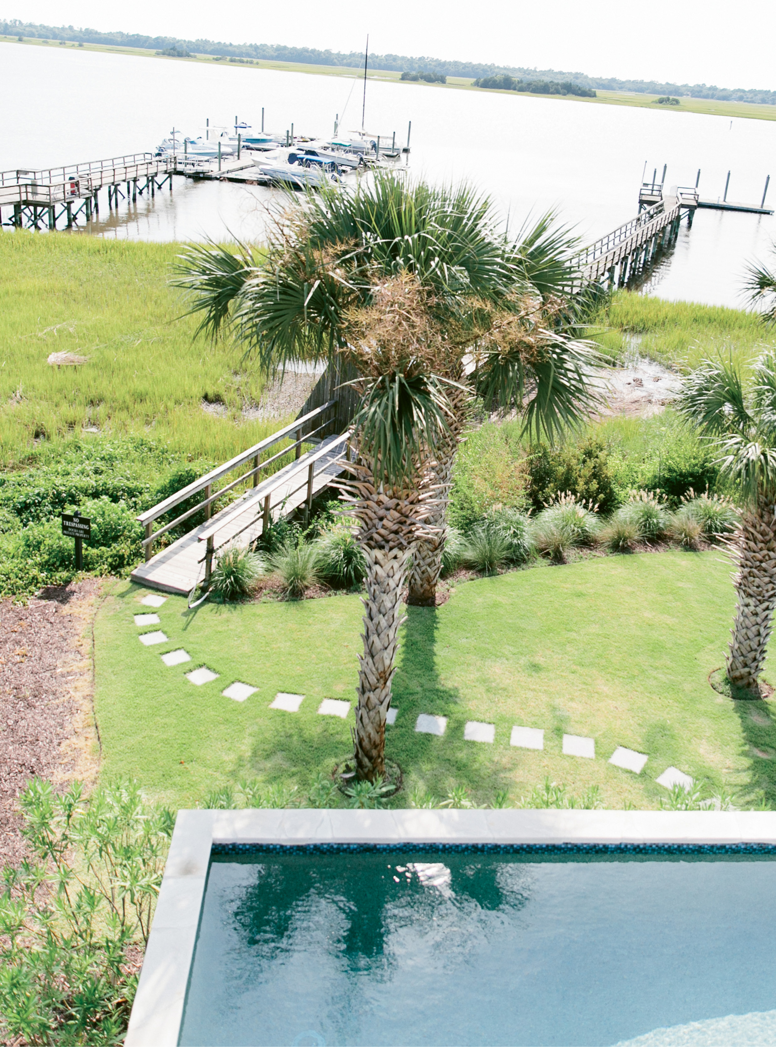 "Stone pavers lead from the pool to the family's dock. ""We're out there a lot; the kids fish and hang out,"" Melissa says."
