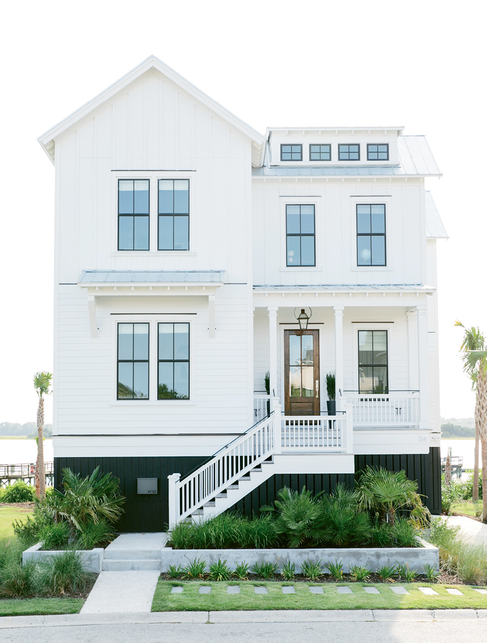 Clean lines and beachy materials make for a modern, coastal facade.