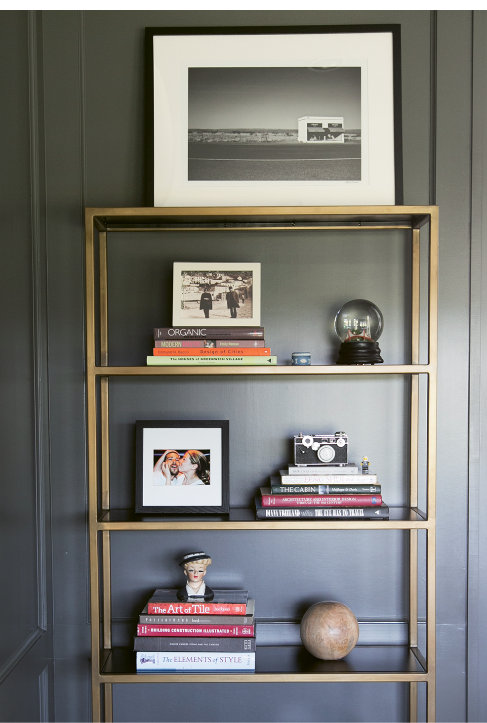 In Melissa's office, gilded shelves display meaningful mementos, such as vintage cameras and Lego figurines that once belonged to her late brother.