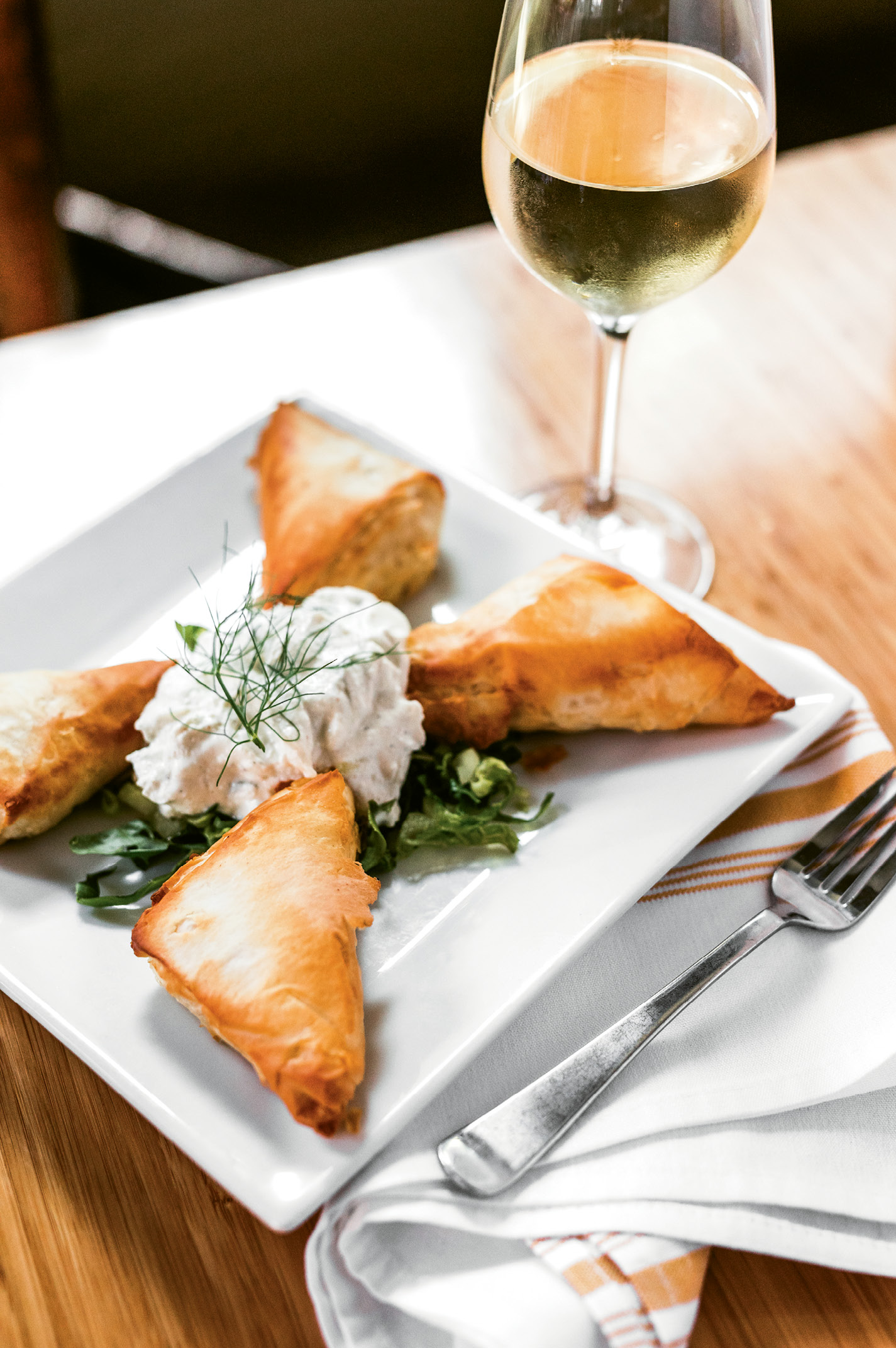 """The Stella Way"": Spanakopita, a flaky phyllo pastry filled with spinach and feta and served with tart tzatziki, is one of the traditional recipes Stella Dikos carried over from her childhood in Greece. At the restaurant, Dikos helps train the kitchen staff to cook in authentic Greek fashion, as she learned herself."