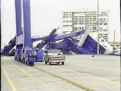 A massive crane toppled at the port