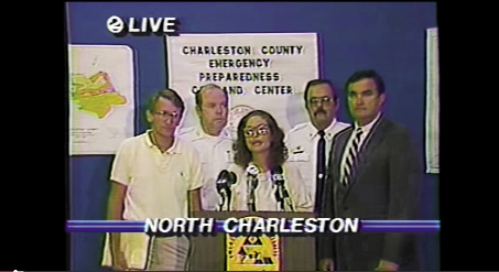 "During a press conference the night before Hugo landed, Charleston County Council chair Linda Lombard (pictured at center)—who continuously repeated the directive ""Leave! Leave now!""—informed residents that Charleston County was under a state of emergency and that Hugo would arrive earlier than first predicted. Mayor Riley (pictured far left) said, ""There will be more flooding as a result of this storm than any Charlestonian has ever experienced...take this remaining window of  opportunity to evacuate."""