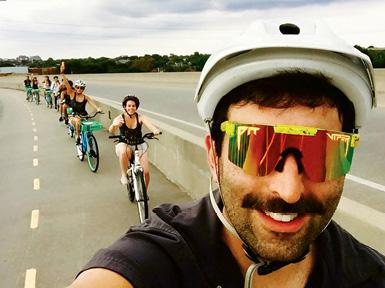 Russell-Einhorn leads a weekend ride up the Ravenel Bridge.