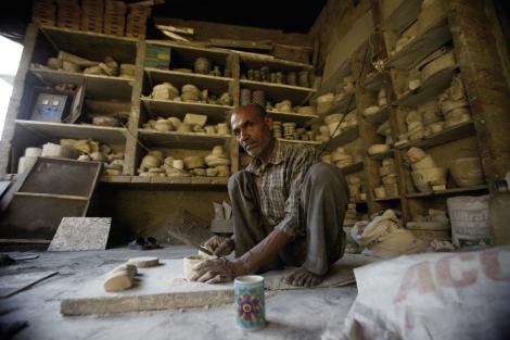 "Still Life: Visiting a blue clay artisan in Jaipur, India, who, Barnhardt says, never said a word but took the time to pose for pictures: ""He sat like that all day and worked nonstop, creating hundreds of cups, pots, and other items. I admired his work ethic."""