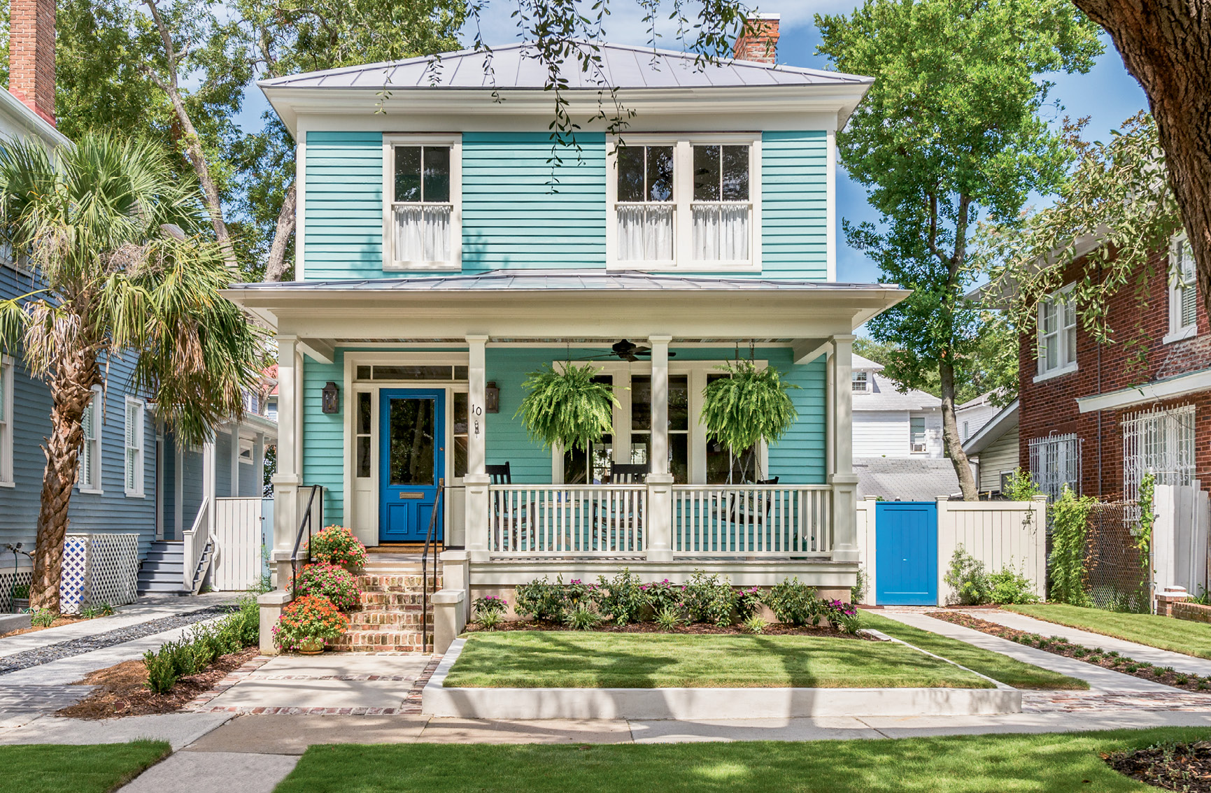 "After: When Cindy and David Ellsworth bought the century-old home, years of neglect had rendered it uninhabitable. With help from contractor Marc Engelke, the couple embarked on a preservation-minded restoration that, in just eight months, returned the abode to its original beauty. With a love for bright colors, Cindy had the exterior painted in Sherwin-Williams's ""Greek Isle."""