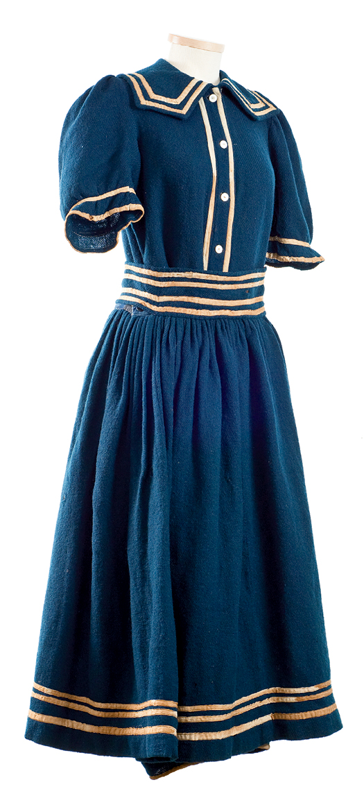 Circa 1890 - It may have become socially acceptable for women to swim in the final years of the 19th century, but they would still have added stockings, shoes, and a cap to this wool suit.