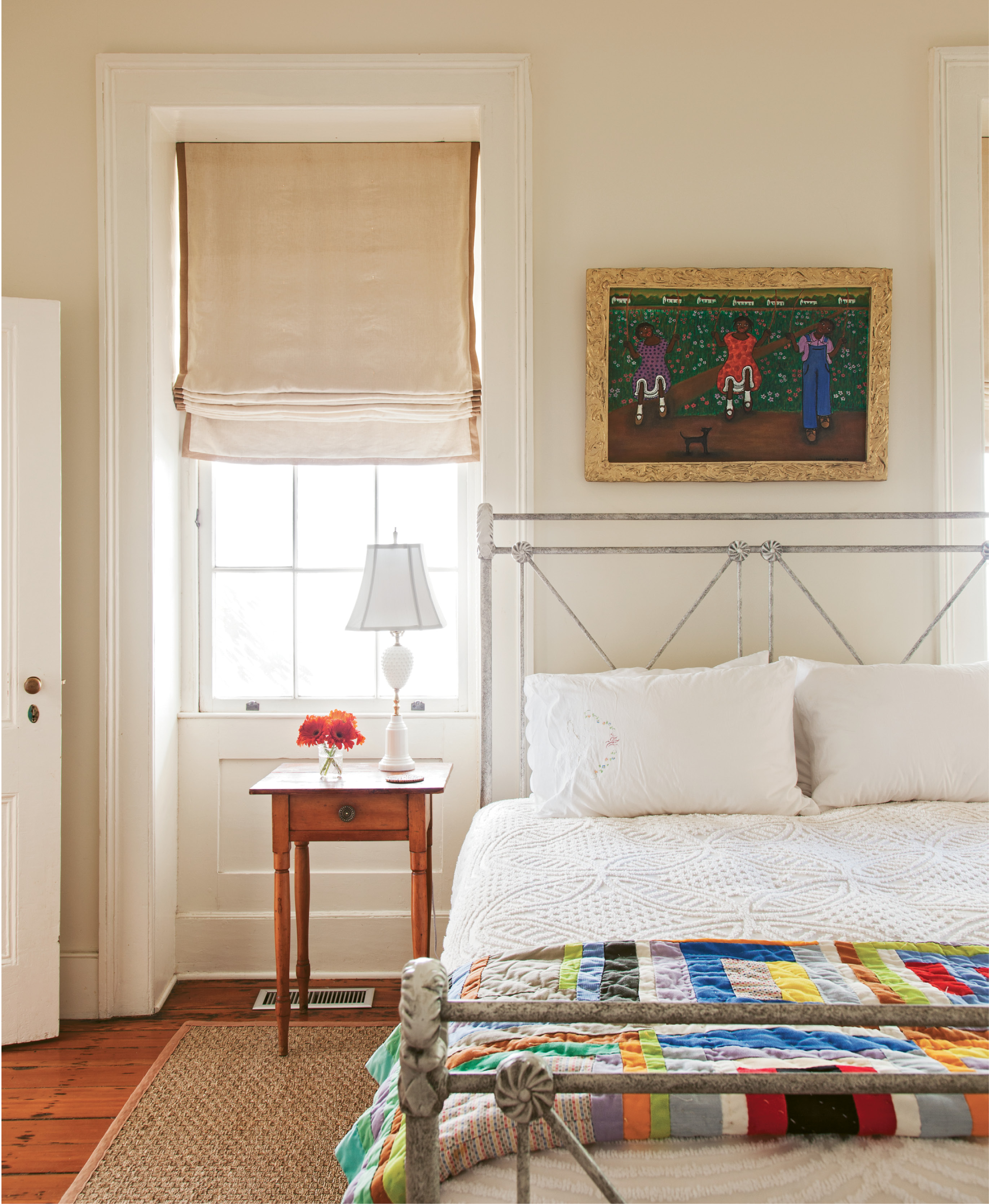 A neutral palette allows the colorful artwork—including a painting by Lorenzo Scott of Atlanta and quilt by Maggie Lou Williams of Bowman, South Carolina—to command visual attention.