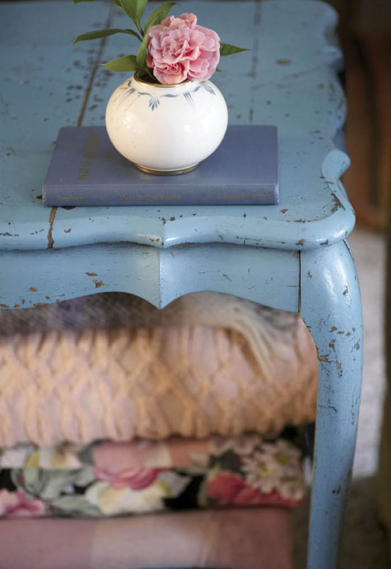 A worn turquoise side table bought off the back of a truck in Columbia.