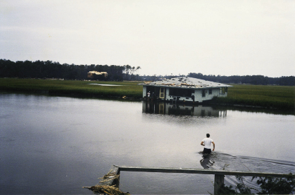 "On Pawley's Island, Dan Love waded out to his neighbor's home, which had floated off its pilings. ""All the pictures were still hanging, the china was in the cabinets—virtually nothing was broken,"" he said."