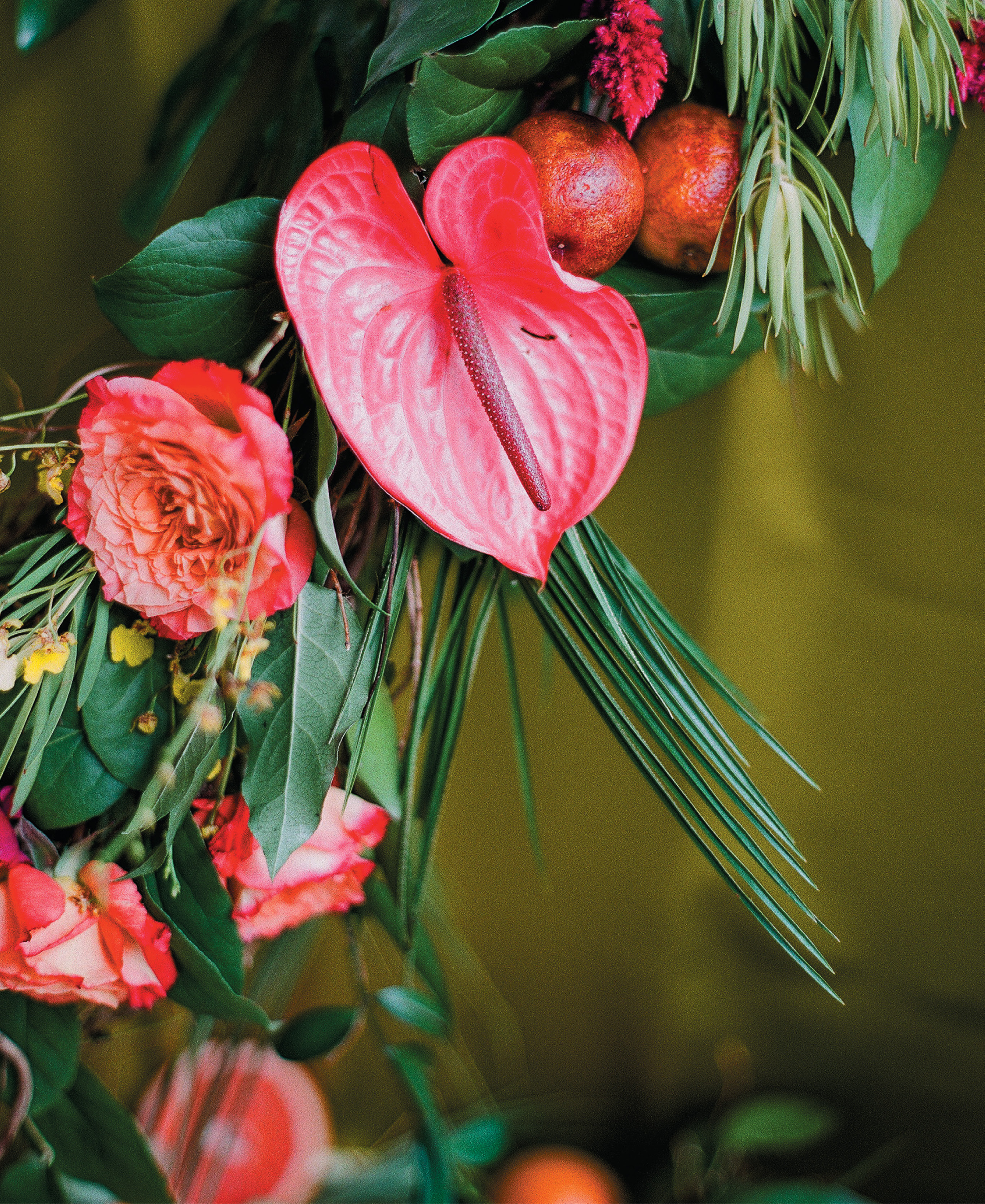 The Vault hostesses Julie Livingston and Reagan Barnes collaborated with floral designer Wimberly Fair on the party's lush, exotic flora, including anthurium, garden roses, pincushion protea, and orchids amidst Leucadendron, monstera, and palm greenery.