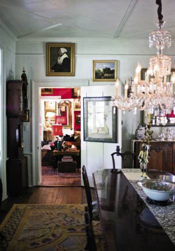 """""""Part of my love for cooking is a passion for dishes,"""" says Gerald, noting that the 18th-century wardrobe (left), where antique Imari is stored, hails from the Far East and was handcrafted with immaculate detail and shellacked in oxblood lacquer."""