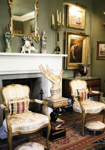 """With the wide scope of objets d'art that adorn these surroundings—such as 1,100-year-old Chinese funerary statues of the Tang Dynasty and a circa-300 B.C. Greek urn (right), fireside chats take visitors around the world and through countless eras. And that, say the home-owners, is the point. """"We love to entertain,"""" says Gerald. """"It's all about sharing."""""""