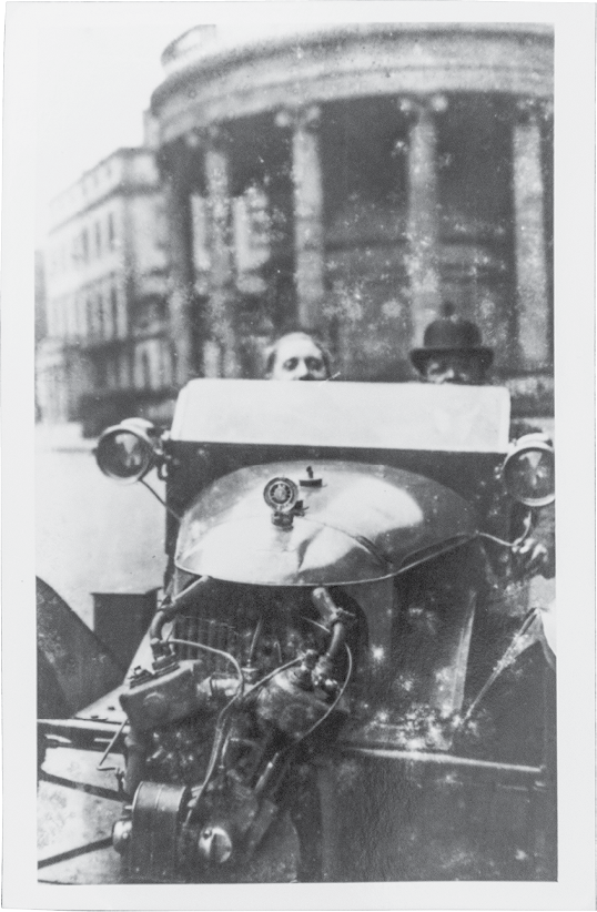 Edmund, driving with a friend (city and date unknown).