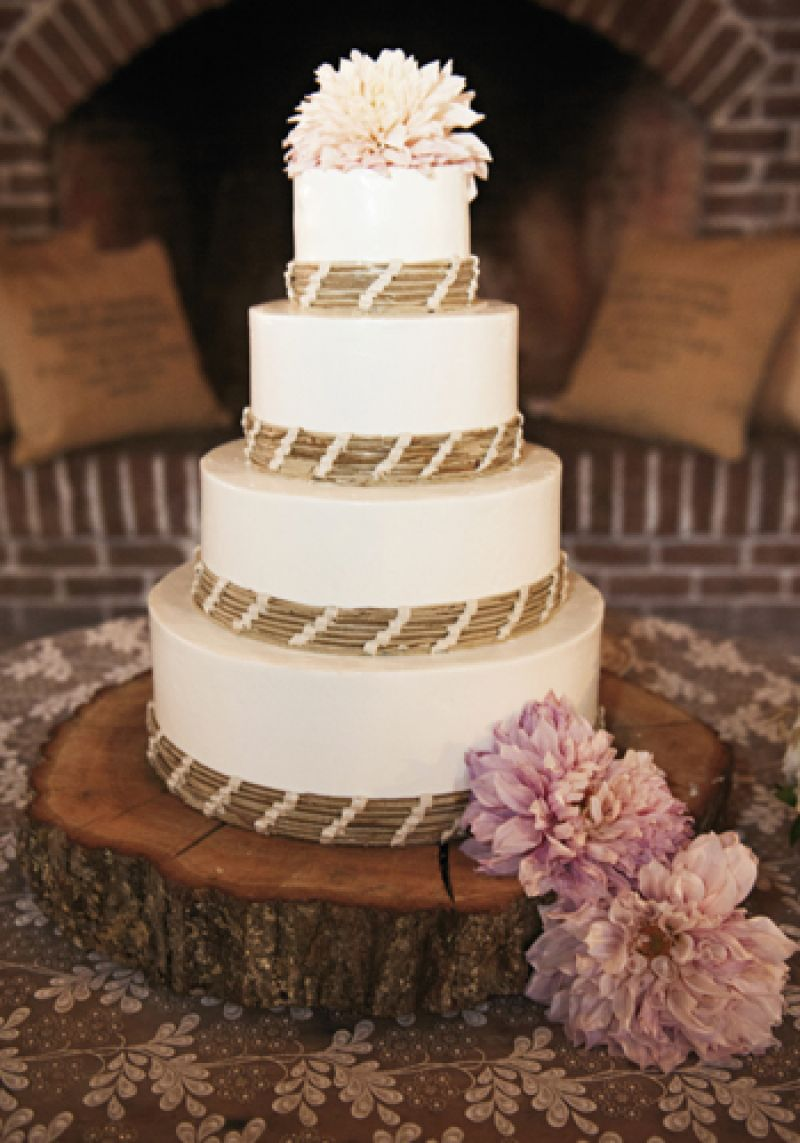 SIMPLE SWEETS: Lauren Mitterer of WildFlour Pastry baked a four-layer confection that she then ringed with wooden shoots banded together with pale pink ribbon.