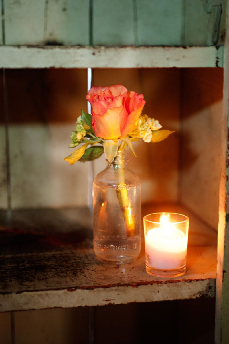 "A LITTLE GOES A LONG WAY: A simple rose and solitary votive echoed Mary's vision of a ""vintage, organic, and laidback Lowcountry"" affair."