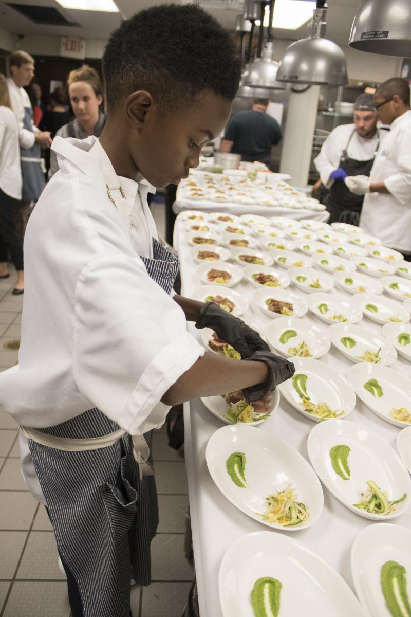 Jaylen Jones gets to work in the kitchen.