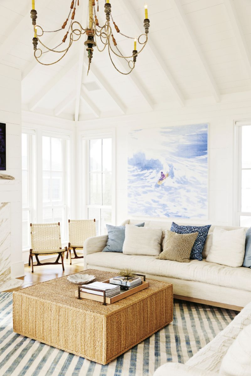The Big Picture: The soothing vista of an endless horizon makes a breathtaking backdrop for this Sullivan's retreat. White shiplap walls give a classic old beach-house feel while showcasing primo contemporary art, like this surfer painting by Isca Greenfield Sanders.