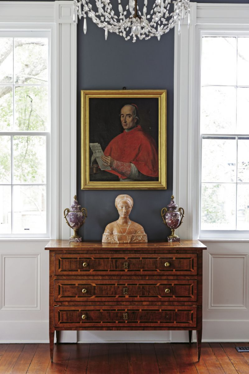 A 16th-century portrait of Cardinal Ardicinus della Porta hangs over a bust of an Italian princess in the front parlor