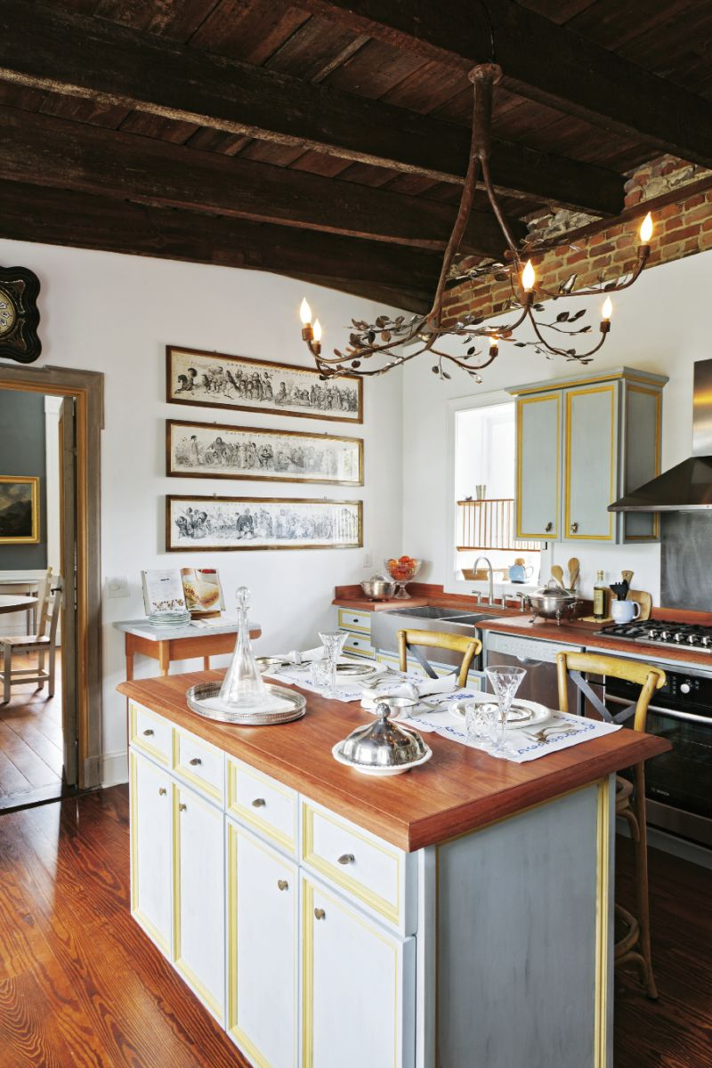 The kitchen  island was built in the style of old Tuscan cupboards by local firm Perrin Woodworking; the chandelier is by Umbrian blacksmith  Alberto Alunni.