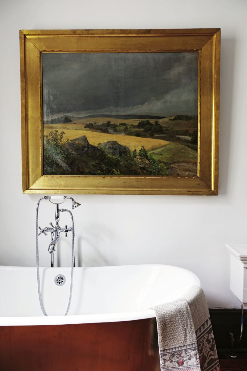 In the master bath, the painting is an antique and depicts the Tuscan countryside.