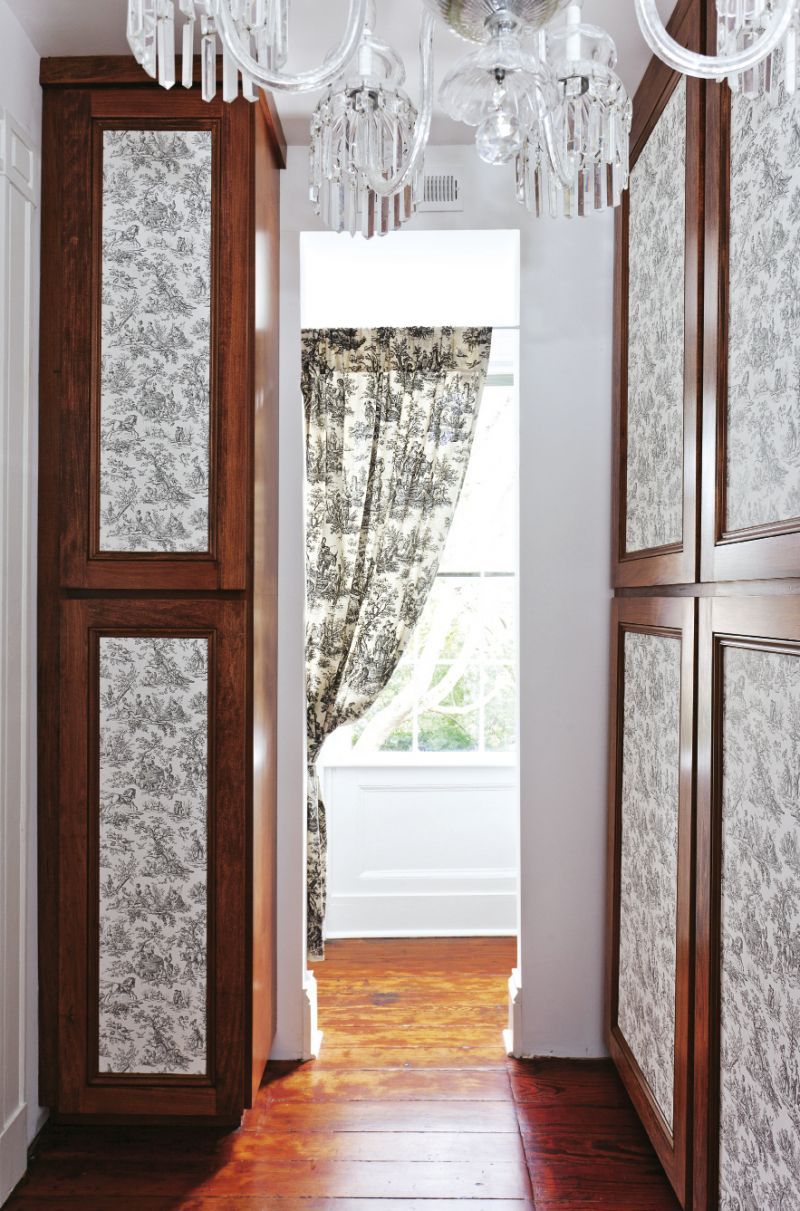 SENSING A PATTERN The pair covered cedar closet door panels in toile wallpaper.