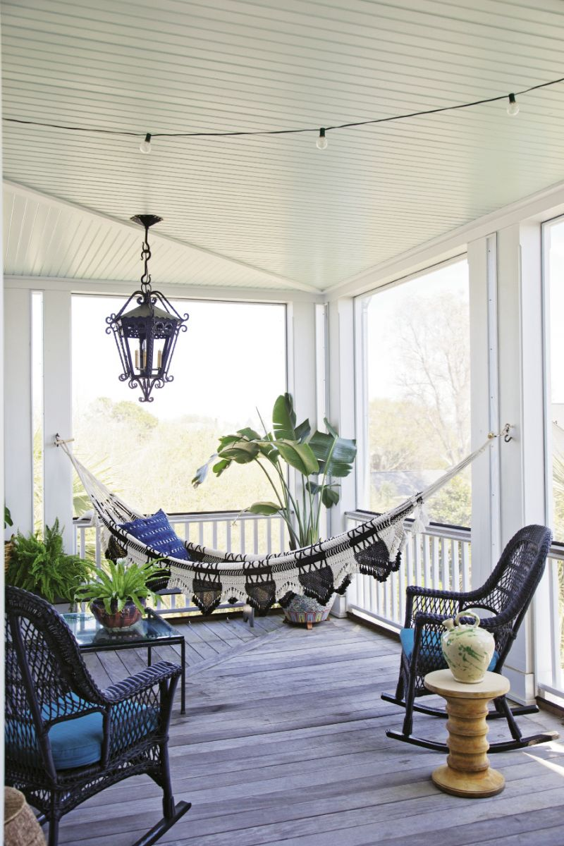 The screened-in porch, located just off the second-floor living room, feels like an extension of the interior. A hammock Lynne picked up in New York strikes a decidedly Bohemian note that's balanced by the traditional silhouette of the iron light fixture.