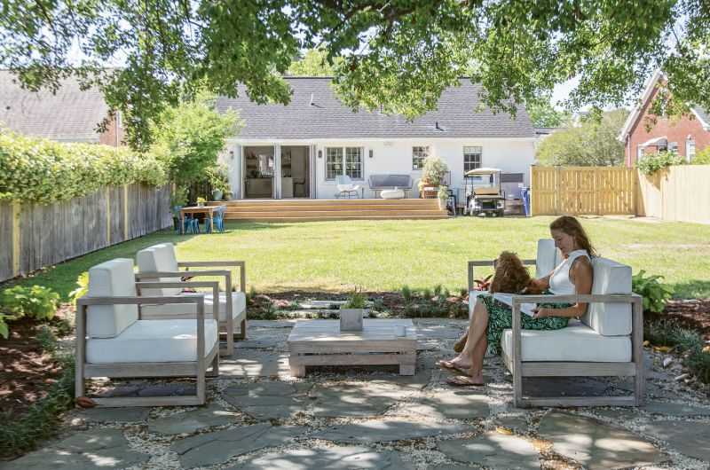 """OUTDOOR OASIS: Two sets of French doors and a sprawling wooden deck add appeal to the rear of the home. But Rachel's work out back has just begun. """"I'm going to have big garden beds on both sides of the yard and plant more trees,"""" she says. """"Then dreamland is to have a pool right in line with the patio."""""""