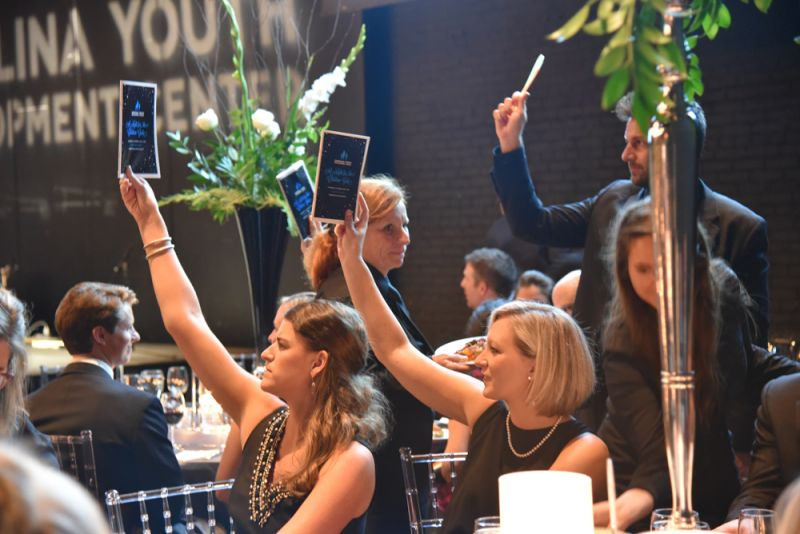 Guests participate in the live auction