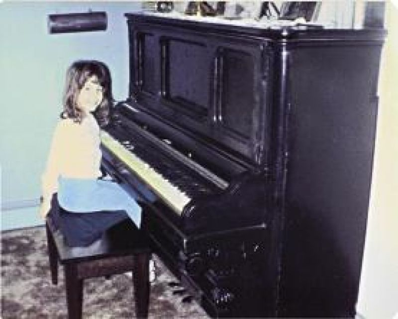 Born to Perform: An eight-year-old Elise playing at home in Kinnelon, New Jersey