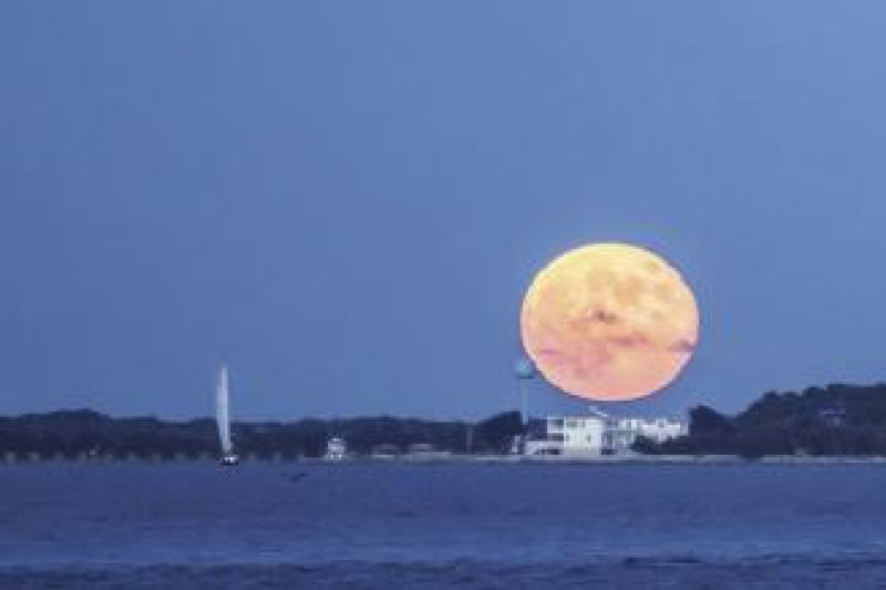 A stunning blue moon rises over a Summer Series race.