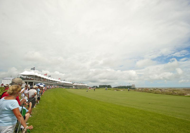 Fans lining the 18th fairway.