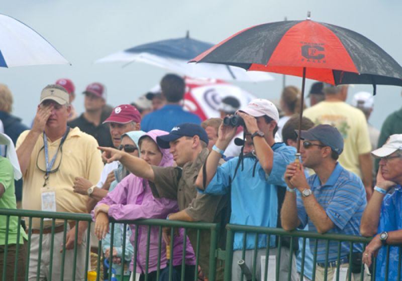 Fans sticking it out in the rain.