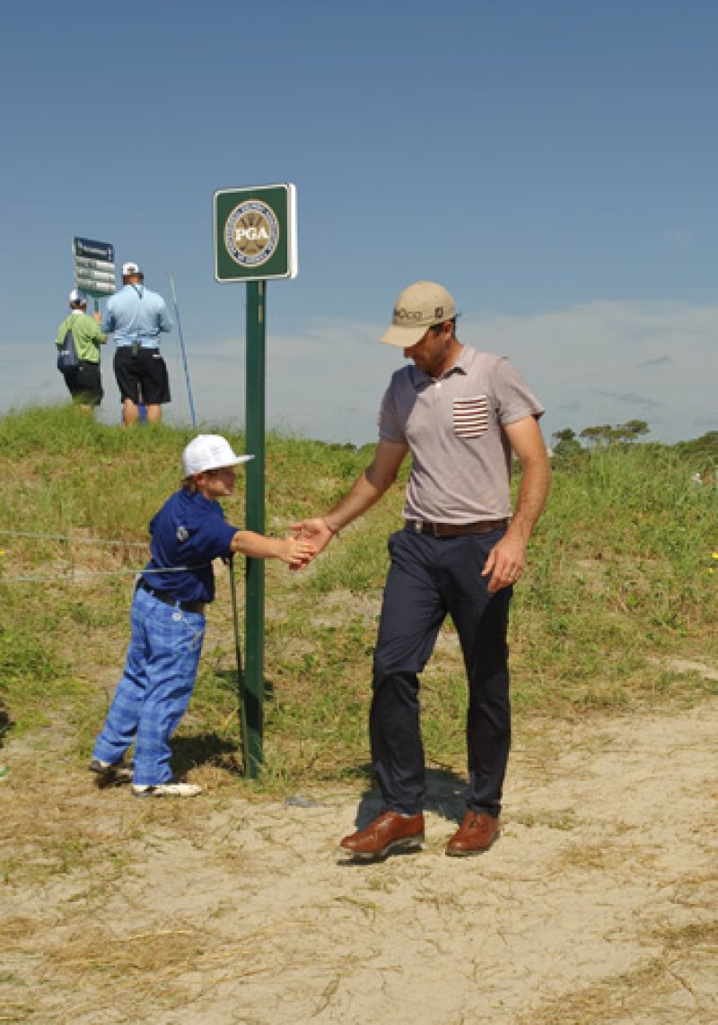 Jeff Ogilvy getting encouragement from a young fan.