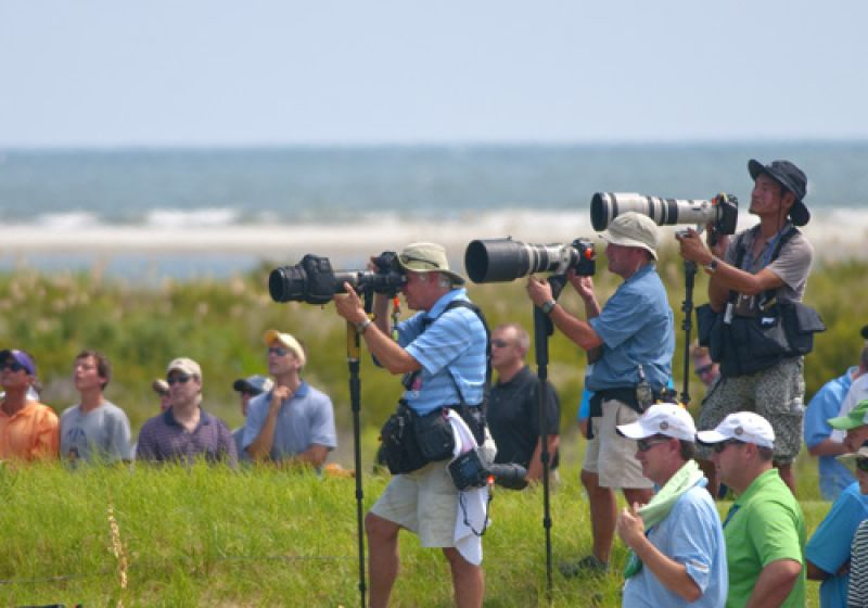 Photographers lining up with the big lenses as Bubba Watson nears the turn.